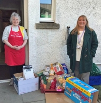 Theresa Bain (right) delivers food to Hope Kitchen, Oban